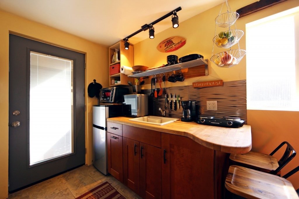 Fully equipped kitchenette, complete with dishes, cups and utensils, pots and pans.